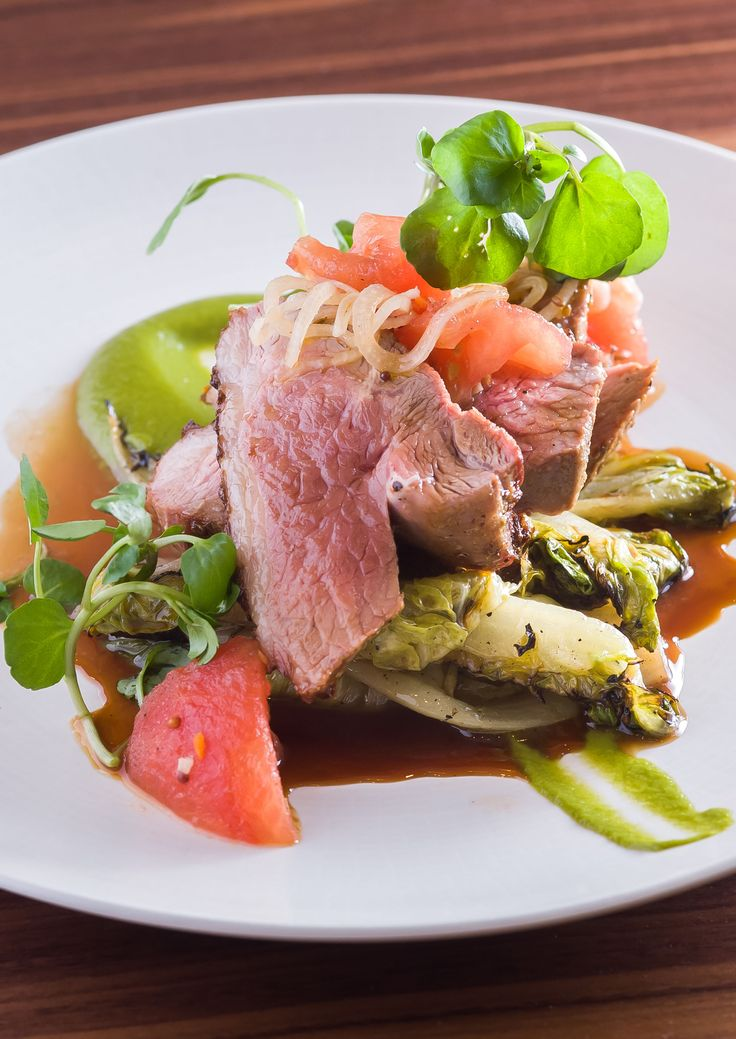 Amchur and fenugreek lamb rumps with leek purée and pickled tomatoes by Anna Hansen