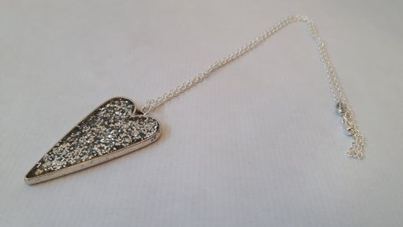 Silver heart glitter necklace silver necklace heart shape. This glittery heart necklace is simple yet beautiful. The pendant is made with silver glitter set in resin within a silver plated bezel pendant. £12.95 Jewellsy #valentinesdaygiftideas #heartshapedpendant