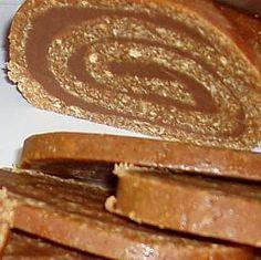 Rotolo di biscotti e nutella - INGREDIENTI: 300 gr di biscotti tipo oro saiwa 100 gr di zucchero 2 cucchiai di cacao amaro 1 bicchiere di caffè 1 bicchiere di nutella 30 gr di burro