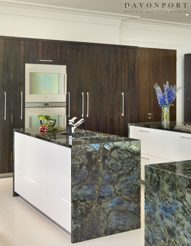 The Labrodite Madagascar granite worktops were sourced by Samantha herself who flew to Italy to choose the exact finish. The dark grey base has flashes of aqua blue, green, yellow and pink. The striking appearance of the granite is balanced by quartz composite surfaces on the island and cream flooring.