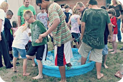 Basically, a small kiddie-sized plastic pool is filled with water AND ice AND marbles. The 4 contestants have to stand in the freezing cold water &, with their toes, fish out the marbles & drop them in a pitcher designated for their team. Whoever collects the most marbles in their container in 2 minutes, wins!