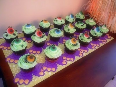 The monster cupcake feet were ordered from Oriental Trading and the eyes are gummy eyes.