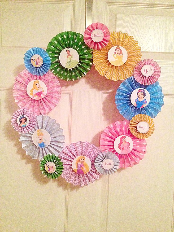 Disney princess wreath using pool noodle and open paper cardstock at michaels, 5 for 1.00! I got inspiration from http://www.3littlegreenwoods.com/2013/08/26/sofia-the-first-wreath-princess-party-on-a-budget/