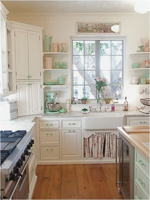 English cottage kitchen. Love the corner storage and the sea foam and pink pieces.