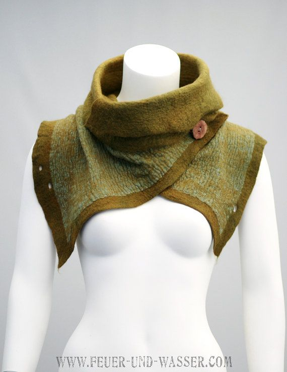 A combination of merino wool, mohair and cotton fabric, hand dyed in the colors of natures moss beds and woods, made in a Nuno-felting technique. Textured and pleasant to the touch, as well as dimensional. This scarf has a romantically rustic, almost antique feeling of an era bygone. It is also reminiscent of post-apocalyptic fashion. This cowl is thick and sturdy, made to last and for everyday wear. Wool is combined with a strong cotton fabric, so it will not be draping as Nuno-felted…