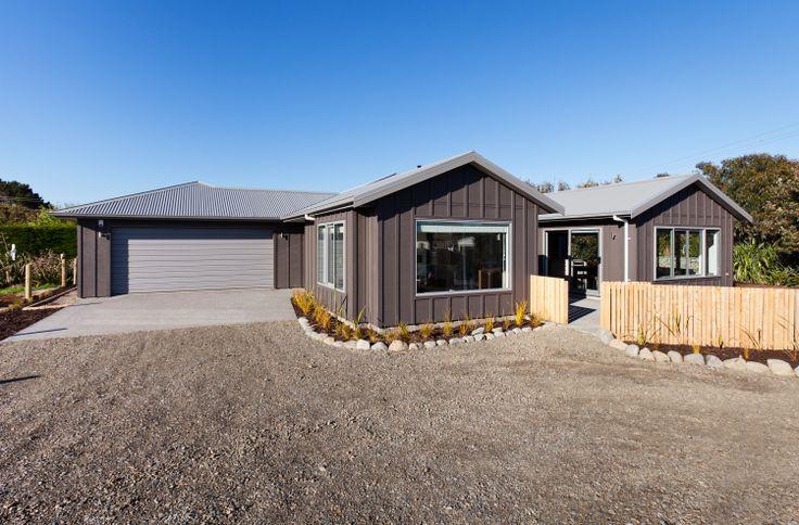 David Reid Homes 2014 Gold Award Winning Coastal Home | Exterior board and batten