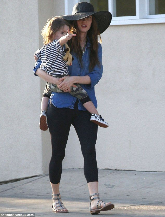 Look over there mummy? Megan Fox was spotted carrying her eldest son Noah after dining out with her family in Los Angeles on Tuesday