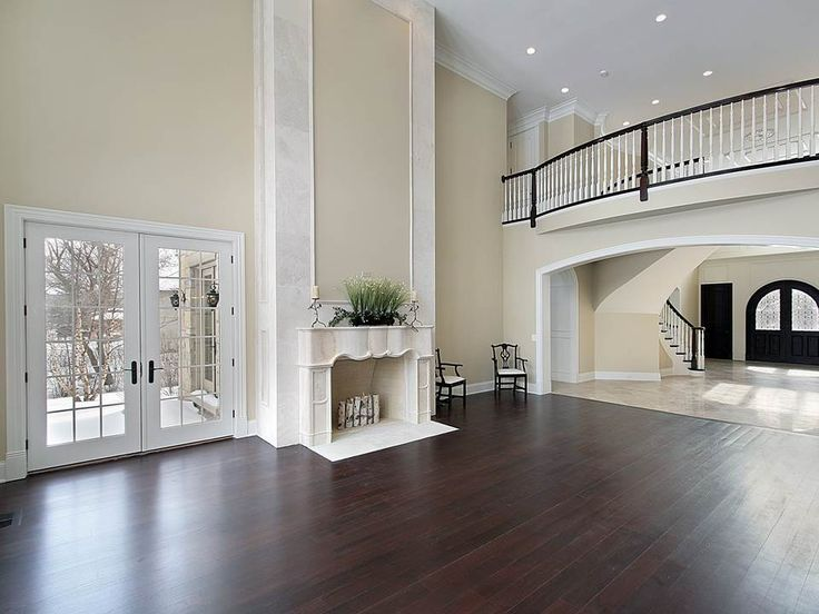 Dark hardwood flooring in Westchester NY. Great balcony, fantastic high ceilings, beautiful natural light from French doors.