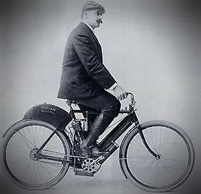 George Hendee, founder of Indian motorcycles, on an early Indian motorbike.