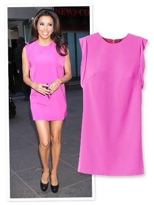 Eva Longoria brightened up a gloomy New York City day with a neon pink dress from Ann Taylor.