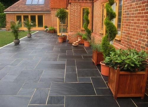 LOVE,LOVE,LOVE Slate. It comes in so many natural colors. Black-based, Autumn colors and some purple-mauve tones as well. Great material.  Blue-Black Slate Paving Slabs - Natural Patio Stone