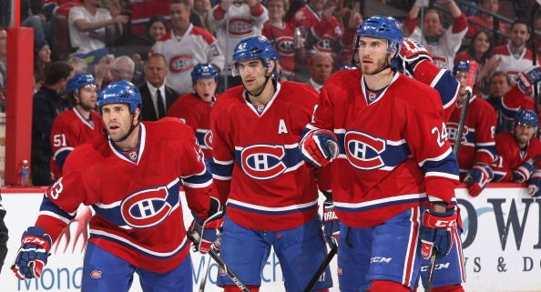 Mike Weaver #43 of Montreal Canadiens celebrates his first period goal against the Ottawa Senators with team mates Max Pacioretty #67 and Jarred Tinordi #24 during an NHL game at Canadian Tire Centre on April 4, 2014 in Ottawa, Ontario, Canada