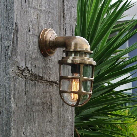 Solid brass fitting with caged glass