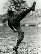 Dwight Eisenhower kicks the football at West Point.