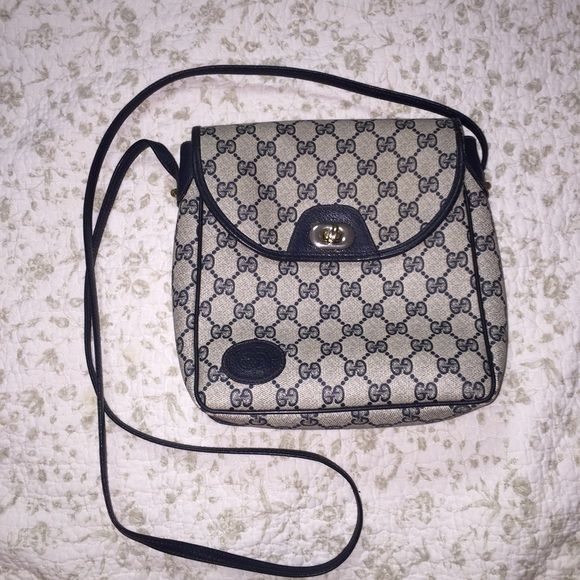 Gucci messenger bag AUTHENTIC Gucci messenger bag, black leather trim and patterns on textured murky brown / gray color. Slight wear and tear, very pre-loved but in good condition! Gucci Bags Crossbody Bags