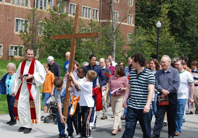Paulist Fr. Eric Andrews leading a Good Friday procession during his years as director of then-Blessed John XXIII University Parish in Knoxville, TN.