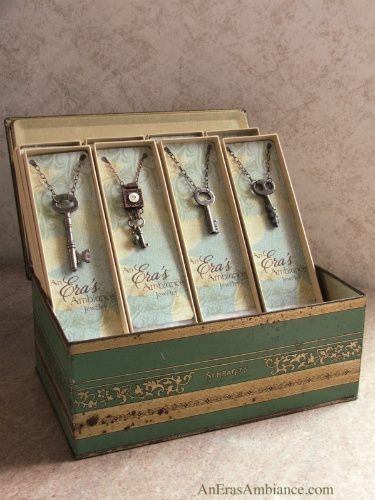 A Vintage Artist:  Upcycled Jewelry Display - love the cards with her logo inside the boxes