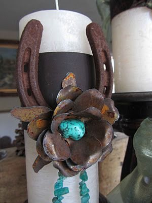 pretty cool horseshoe, flower and turquoise candle wrap - great centerpiece idea!