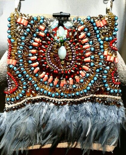 Hand beaded kilim satchel by Anita Quansah London for AfrikHai featuring a combination of varying beads with feathers.