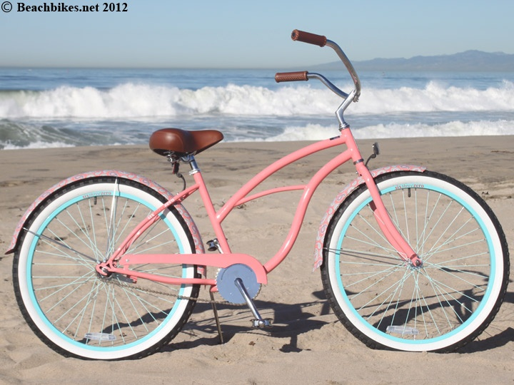 Coral pink beauty of the Pashley variety please with a basket for my homemade cupcakes : )