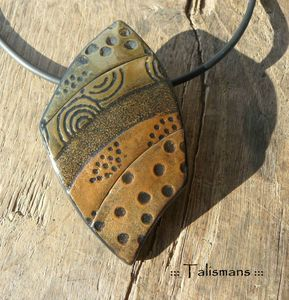 polymer clay. Talismans. Love the rugged simplicity.
