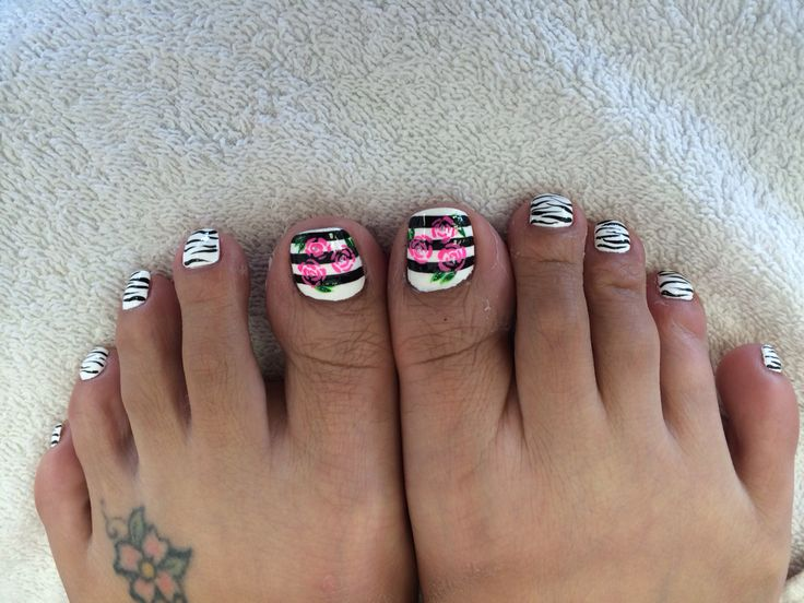 Cute roses designs for toes. #Cute #roses #zebraprint #zebra #nail #art