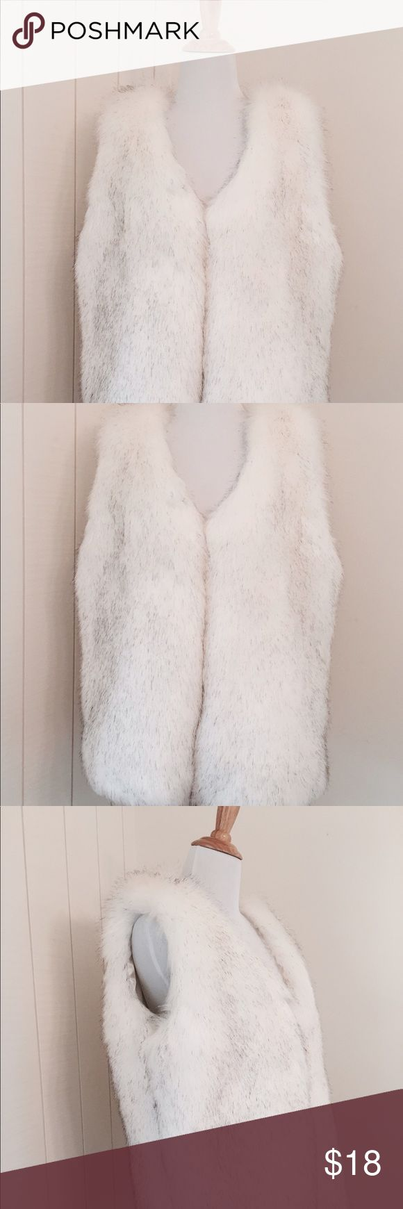 GLAMOROUS white faux fur vest This faux fur vest feels like the real thing(!).  * Beautiful and soft white fur with tips of black.  * Pristine white satin lining.  * Just in time for Spring/Summer nights * Excellent condition Jackets & Coats Vests