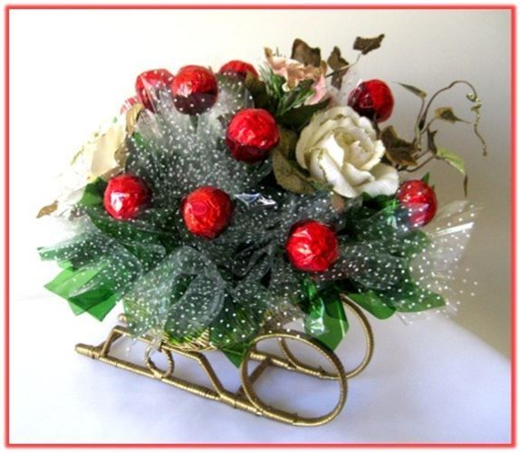 """GOLDEN SLEIGH"" Candy Bouquet  Get them ready for the Holidays with a sleigh ride of chocolates....  A beautiful Christmas centerpiece!"