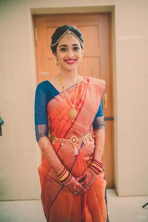 Pretty south indian bride candid portrait with traditional  gold jewellery. Kanjivaram traditional saree fashion.
