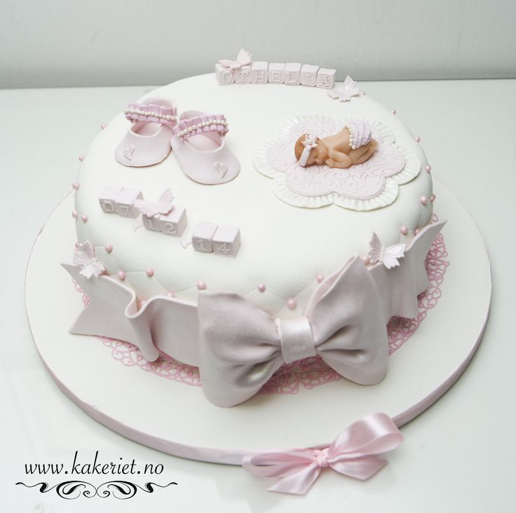Christening cake baby girl with shoes and bow