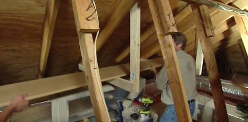 """How to easily build storage shelves in attic with sloping roof. All you need is some 2x4's and 1"""" thick shelving and screws."""