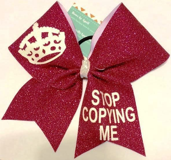Bows by April - Stop Copying Me Red Glitter Cheer Bow, $16.00 (http://www.bowsbyapril.com/stop-copying-me-red-glitter-cheer-bow/)