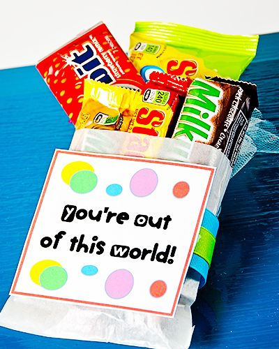 You're Out of This World Valentine- Milky Way, Orbit, Starbursts.... cute!  I am thinking this would be better with mini candies if giving to kids