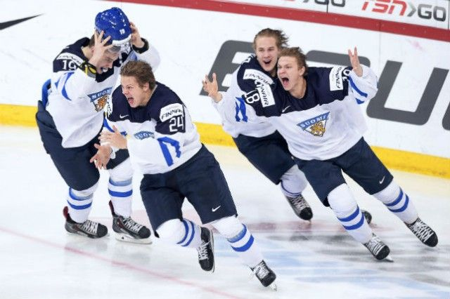 Team Finland celebrate a 4-3 gold medal game win over Russia at the 2016 IIHF World Junior Championship.