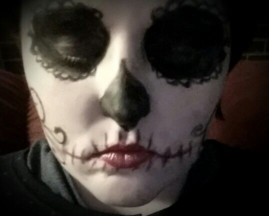 Day of the dead trial #1 using Maybelline eyestudio (blackest black) eyeliner, Maybelline  (colossal) mascara, Wet n Wild lipstick (cherry frost), and Mary Kay Signature (burgundy) lip liner as well as Mary Kay foundation