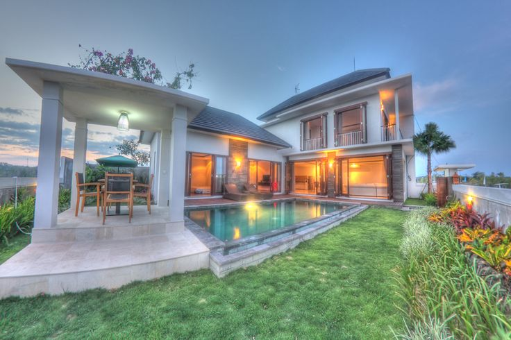 Elegant 2-story home with pool surrounded by home and gazebo