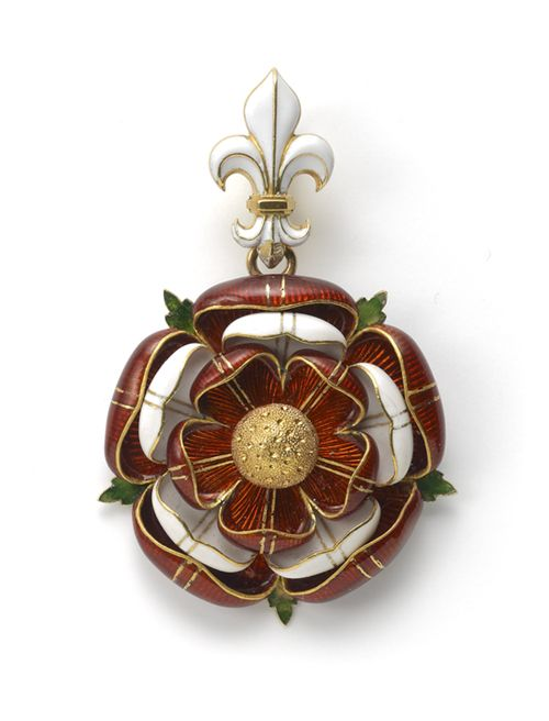 A Gold and Enamel Pendant by Robert Phillips in the form of the Tudor Rose, executed in red and white enamel, highlighted with stylised green enamel leaves which radiate from the back, the whole suspended from a white enamel Fleur de lys. London, circa 1875