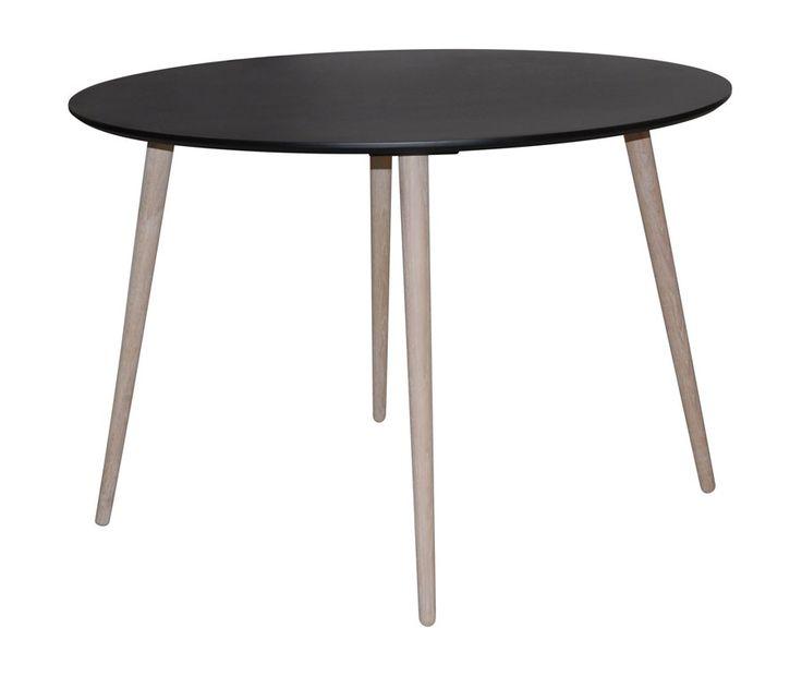Stavanger+spisebord+-+Elegant+spisebord+med+sortmalet+bordplade+og+ben+i+hvidolieret+egetræ.+ Spisebordet+har+med+den+sortmalede+runde+bordplade+referencer+til+retrostilen,+imens+de+hvidolierede+ben+i+eg+leder+tankerne+hen+på+den+nye+nordiske+stil.+Sammensat+er+bordet+et+moderne+bud+på,+hvordan+man+smukt+kan+forene+sin+hang+til+retro+med+det+nordiske+look. Stavanger+er+en+komplet+serie+af+både+spiseborde,+sideborde+og+sofaborde.