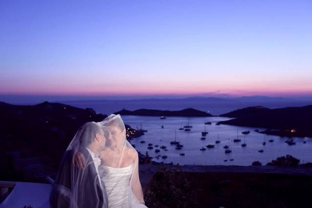 The happy couple after the ceremony,with the view of Aegean Sea in Kea Island.Aigis Suites