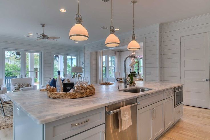 Traditional Kitchen with Kitchen island, Pendant light, Complex marble counters, specialty door, Flush, Flat panel cabinets