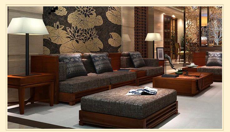 Темно-серый диван из массива дерева в интерьере гостиной в стиле арт-деко