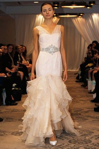 "Justina McCaffrey Fall 2014: sheer straps, diamante belt, cascading ruffles wedding dress. I don't know if the shoes are supposed to ""play peek-a-boo"" or not but I would go with dramatic shoes just in case."
