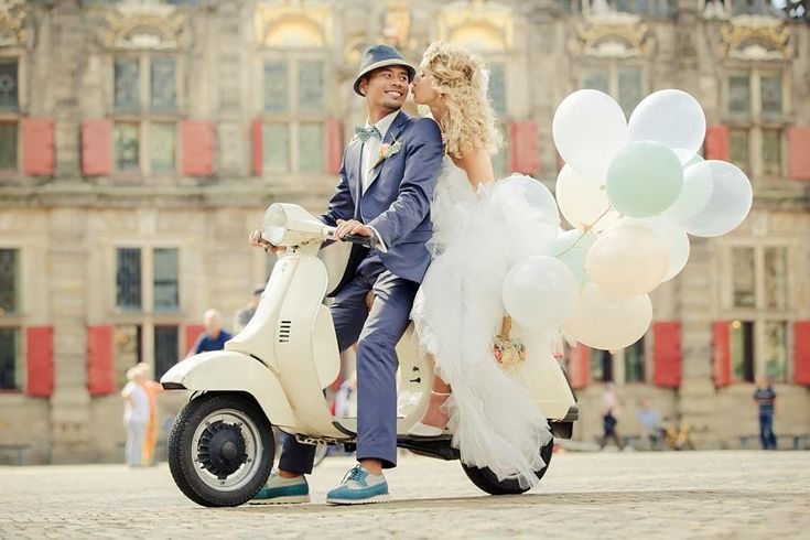 Here's a cute wedding idea: Arrive by motor scooter or Vespa–just like how they do in Italy!