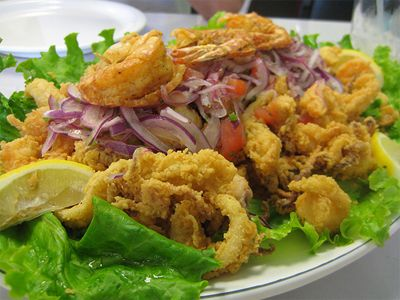 Jalea Mixta - Peruvian dish - Assorted deep fried seafood with pickled red onions