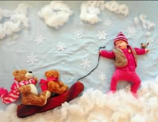 sleeping baby sledding