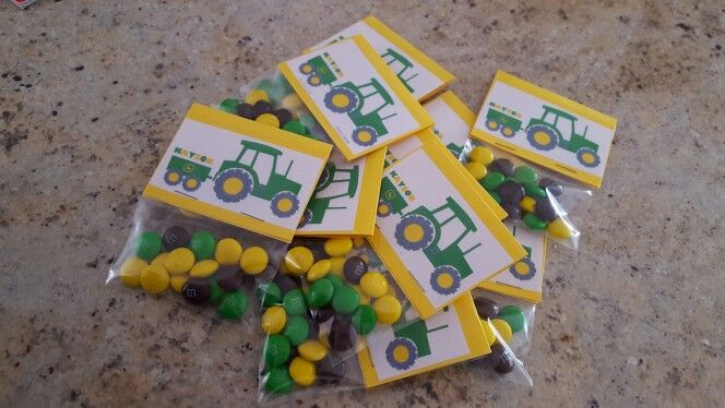 John Deere personalized M&M party favors!!   Bags and cardstock from Michaels, printed tractor clipart from online and separated the M&Ms from a large bag :)
