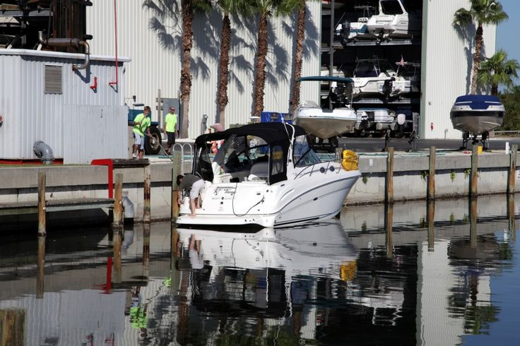 Wet slips in water dock harbortown marina merritt for Boat garage on water
