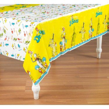Plastic tablecloth, which can cut up in large squares to wrap around framed canvas and use as wall decor.  Could also cut long strips of just the yellow portion to use as background banners.