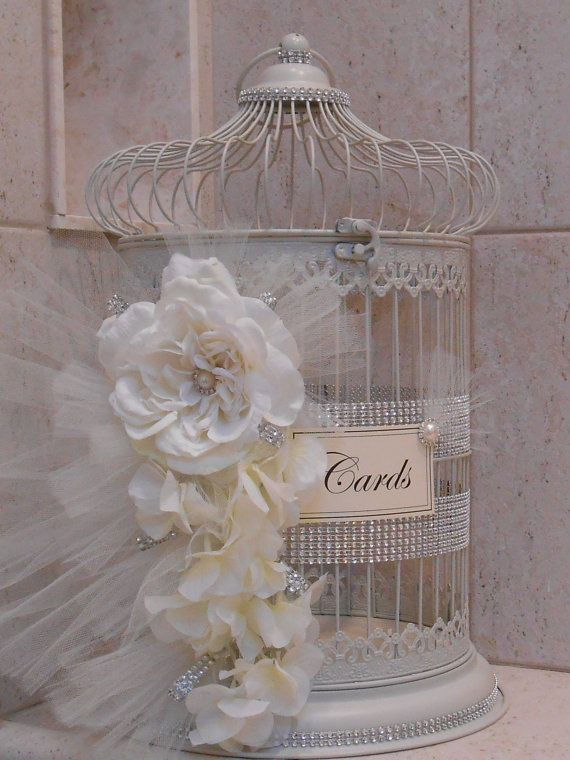 This beautiful birdcage wedding card holder would be the perfect piece to add to any romantic elegant gift table. Cage has a creamy/white finish and