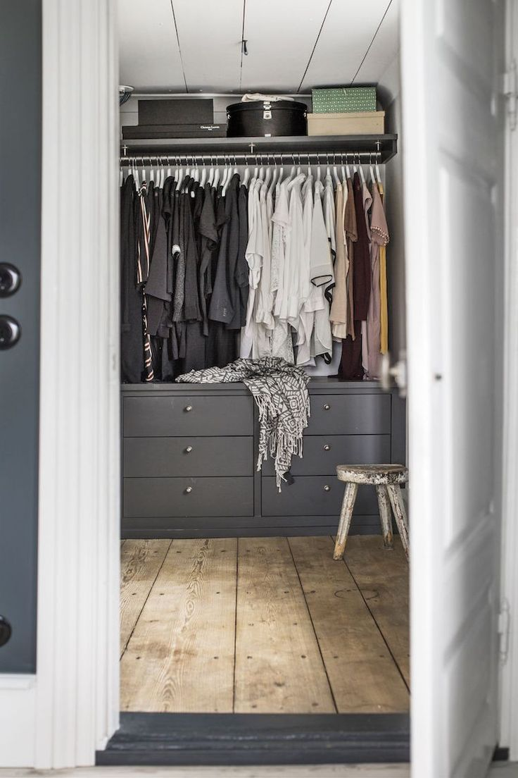 Grey and white walk-in-wardrobe in a Swedish Family Home in a